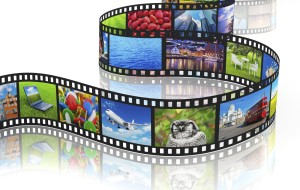 Streaming media concept: filmstrip with colorful photos isolated on white background with reflection effect
